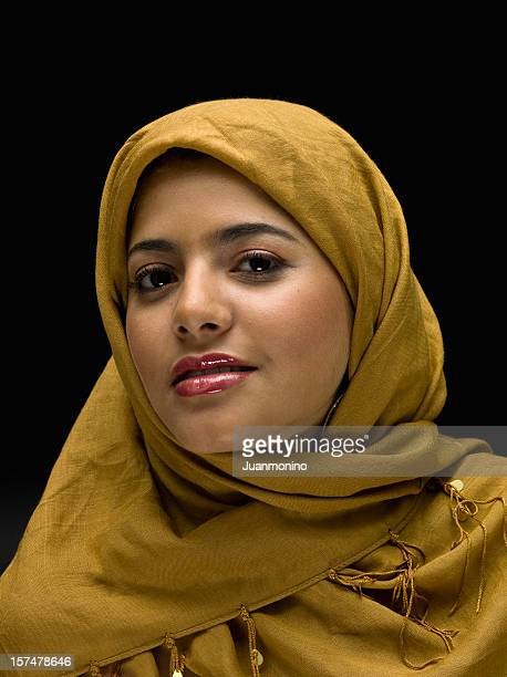 muslim young woman - religious dress stock photos and pictures