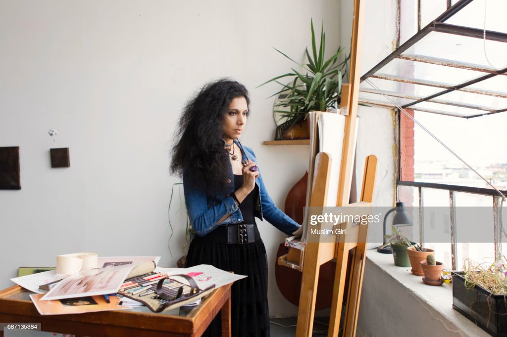 #MuslimGirl Artist Sketching In Beautiful Studio Loft : Stock Photo