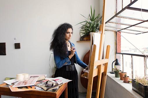 #MuslimGirl Artist Sketching In Beautiful Studio Loft - gettyimageskorea