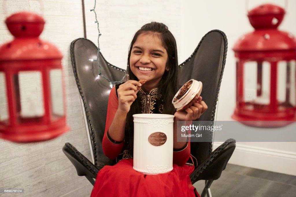 #MuslimGirl Iftar during Ramadan - Eating Treats : Stock Photo