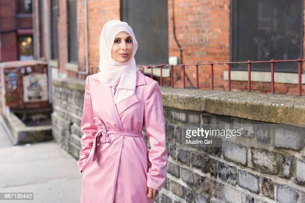 #muslimgirl in pink coat - muslimgirlcollection stock pictures, royalty-free photos & images