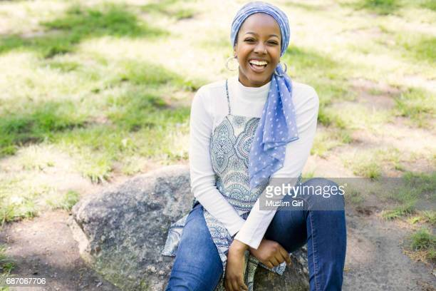 #muslimgirl laughing in a park - muslimgirlcollection stock pictures, royalty-free photos & images