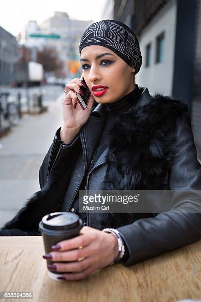 #muslimgirl on the phone with coffee - muslimgirlcollection stock pictures, royalty-free photos & images