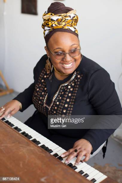 #muslimgirl playing piano - muslimgirlcollection stock pictures, royalty-free photos & images