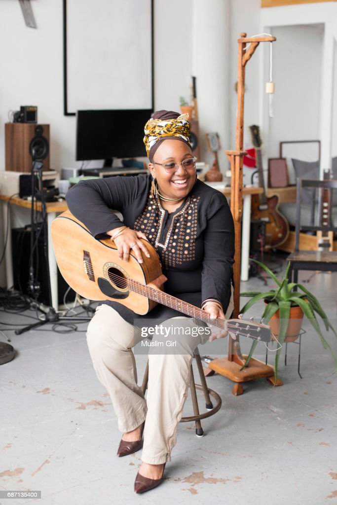 #MuslimGirl With An Acoustic Guitar : Stock Photo