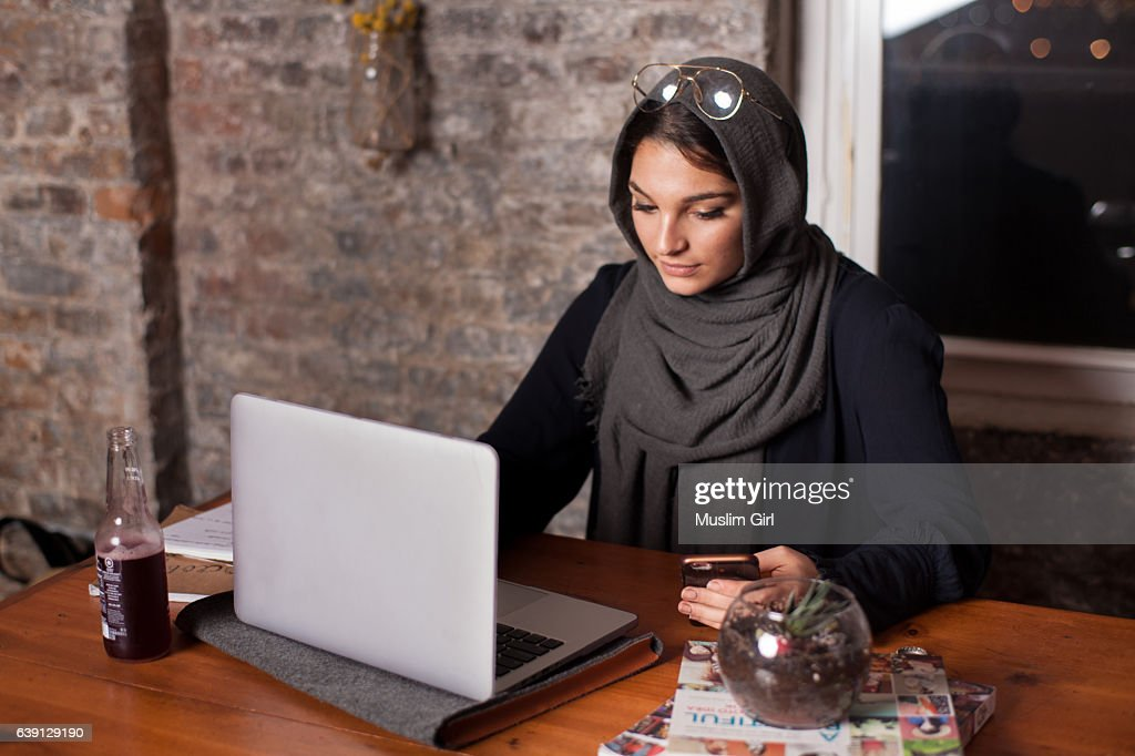 #MuslimGirl working on the computer : Stock Photo