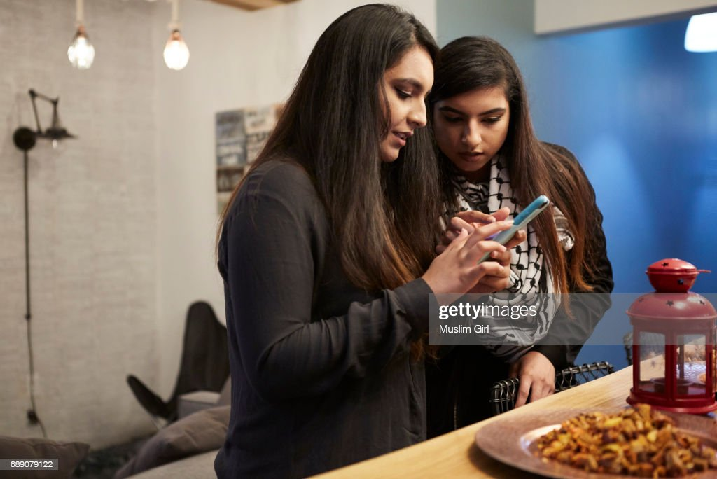 #MuslimGirls Checking on Friends : Stock Photo