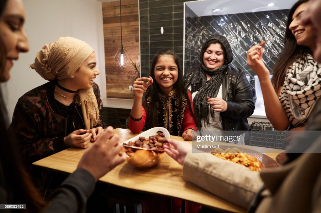 #MuslimGirls Iftar for Ramadan - Snacking Together : Stock Photo