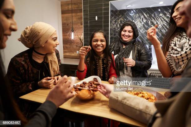 #muslimgirls iftar for ramadan - snacking together - ramadan stock pictures, royalty-free photos & images