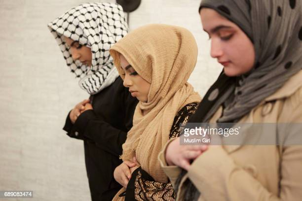 #muslimgirls ramadan - group prayer - religion stock pictures, royalty-free photos & images