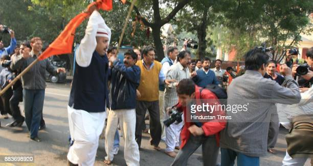 Muslims and activists of Hindu nationalist Shiv Sena party fight each other after the Shiv Sena activists disrupted a gathering of Muslims protesting...
