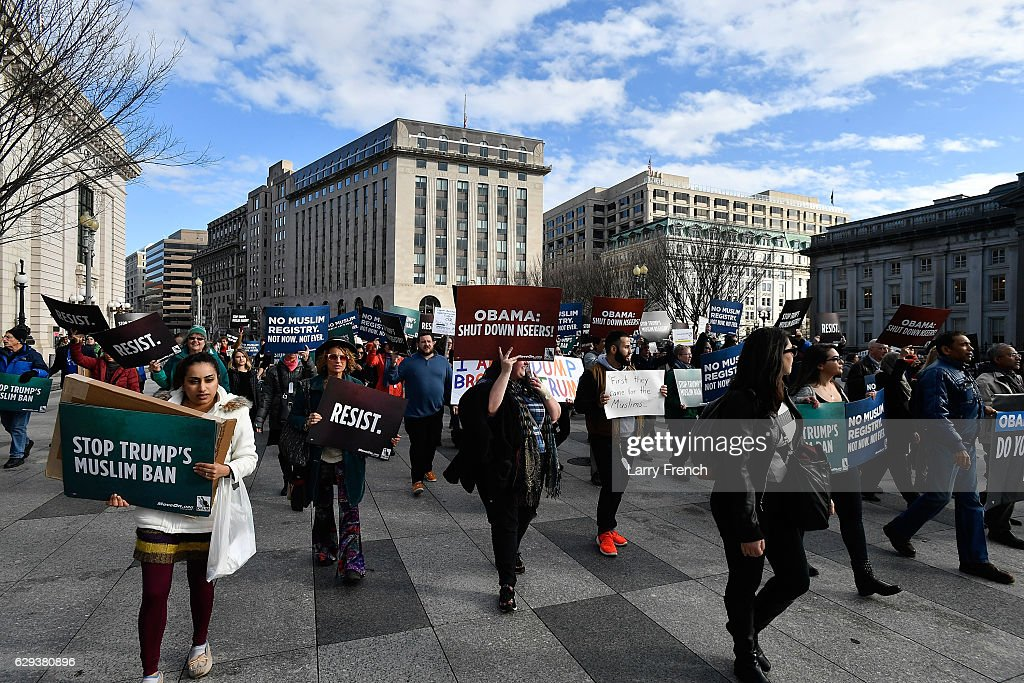 Muslims and Allies march from the Department of Justice to the White House to ask President Obama to rescind NSEERSn for the #NoMuslimRegistry Campaign on December 12, 2016 in Washington, DC.