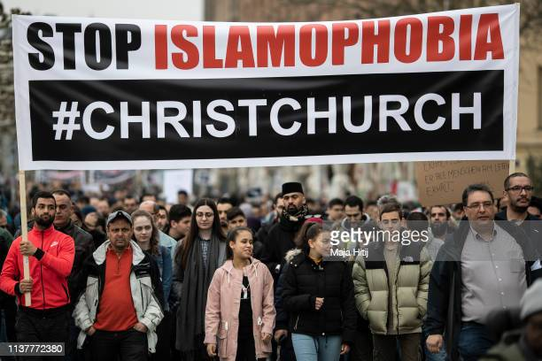 Muslims and visitors protest with a banner that reads Stop Islamophobia #Christchurch during a quiet march to Commemorate Christchurch Victims on...