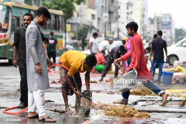 Muslims are seen cleaning the meat after slaughtering a sacrificial animal during the Muslim festival Eid al-Adha or the 'Festival of Sacrifice in...