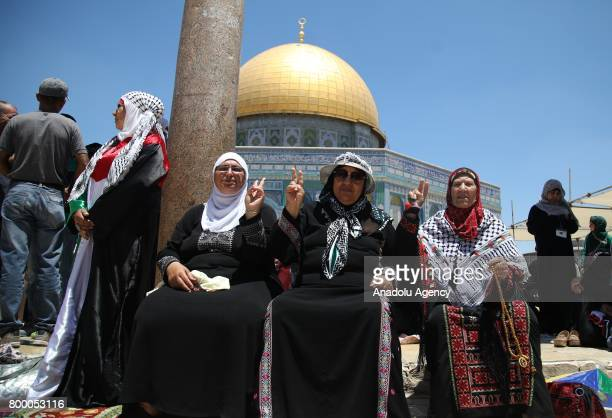 Muslims arrive at Al-Aqsa Mosque to perform the last Friday Prayer of the Muslim's holy fasting month of Ramadan in Jerusalem on June 23, 2017.