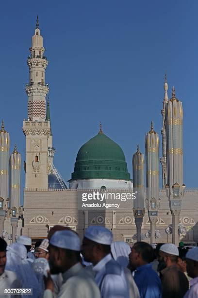 Muslims arrive at Masjid alNabawi to perform the Eid alFitr prayer in Medina Saudi Arabia on June 25 2017 Eid alFitr is a religious holiday...