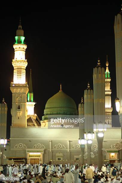 Muslims arrive at Masjid alNabawi to perform the Eid alFitr prayer in Medina Saudi Arabia on June 25 2017 Eid alFitr is a religious holiday...