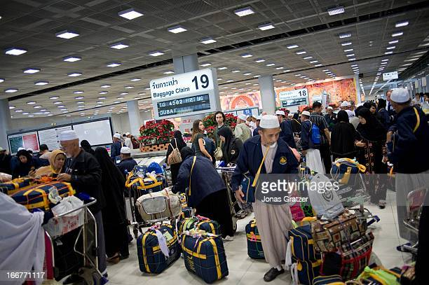 Muslims arrive at Suvarnabhumi International Airport in Bangkok after a trip to the holy city of Mecca
