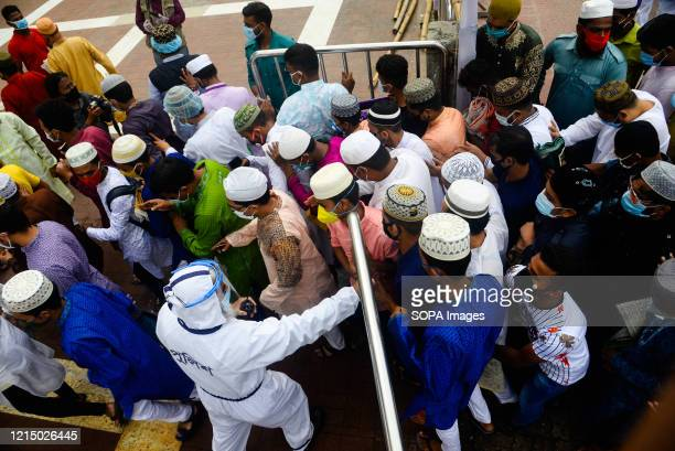 Muslims arrive at the Baitul Mukarram National Mosque to perform Eid al-Fitr prayers. Eid Al-Fitr marks the end of the holy fasting month of Ramadan.