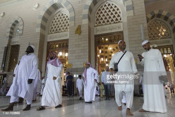 Muslims arrive for dawn prayer at Masjid alNabawi the mosque that incorporates the final resting place of Prophet Muhammad and the first two Rashidun...