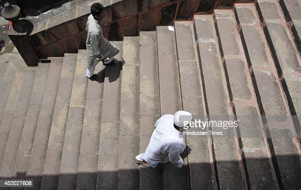 Muslims arrive for prayer during the second Friday of Holy month of Ramadan at Moti Masjid on July 11 2014 in Bhopal India During Ramadan Muslims...