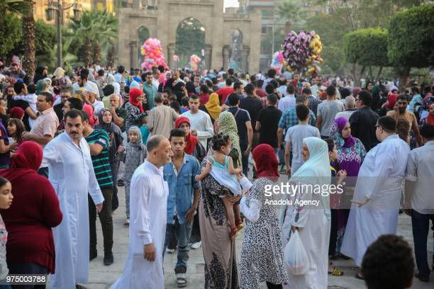 Muslims arrive to perform Eid alFitr prayer at MosqueMadrassa of Sultan Hassan in Cairo Egypt on June 15 2018 Eid alFitr is a religious holiday...