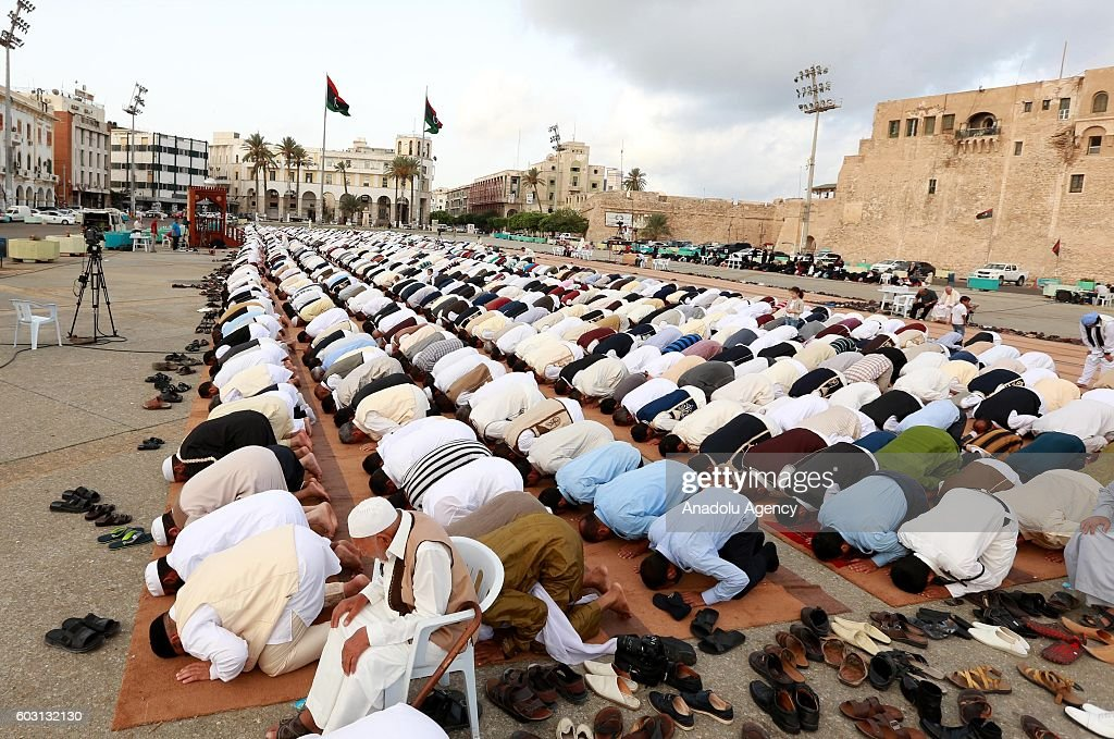 Muslims arrive to perform the Eid Al-Adha (Feast of Sacrifice) prayer at es-Suheda Square in Tripoli, Libya on September 12, 2016. Muslims worldwide celebrate Eid Al-Adha, to commemorate the holy Prophet Ibrahim's (Prophet Abraham) readiness to sacrifice his son as a sign of his obedience to God, during which they sacrifice permissible animals, generally goats, sheep, and cows. Eid-al Adha is the one of two most important holidays in the Islamic calendar, with prayers and the ritual sacrifice of animals.