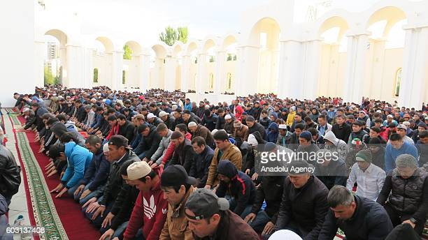 Muslims arrive to perform the Eid AlAdha prayer at NurAstana Mosque in Astana Kazakhstan on September 12 2016 Muslims worldwide celebrate Eid AlAdha...