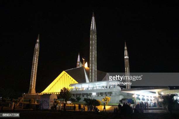Muslims arrive to perform the first 'Tarawih' prayer on the eve of the Islamic Holy fasting month of Ramadan at Faisal Mosque in Islamabad Pakistan...