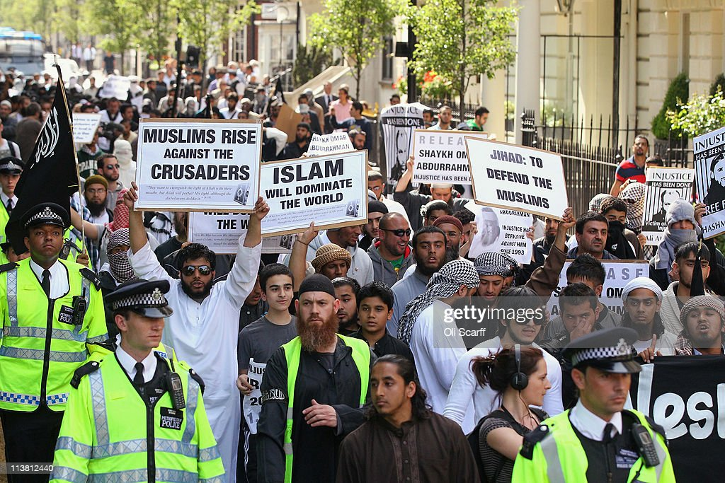 Muslims arrive to protest against the killing of Osama bin Laden outside the US embassy in Mayfair on May 6, 2011 in London, England. The demonstration, which was called by radical Muslim cleric Anjem Choudary, was in close proximity to a rival protest by the English Defense League who were celebrating the death of the al-Queda leader.