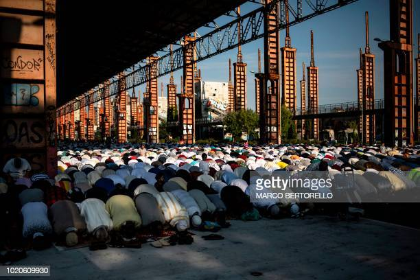 Muslims attend a morning prayer at the industrial wasteland of Parco Dora in Turin on August 21 on the first day the Eid alAdha or Feast of Sacrifice...