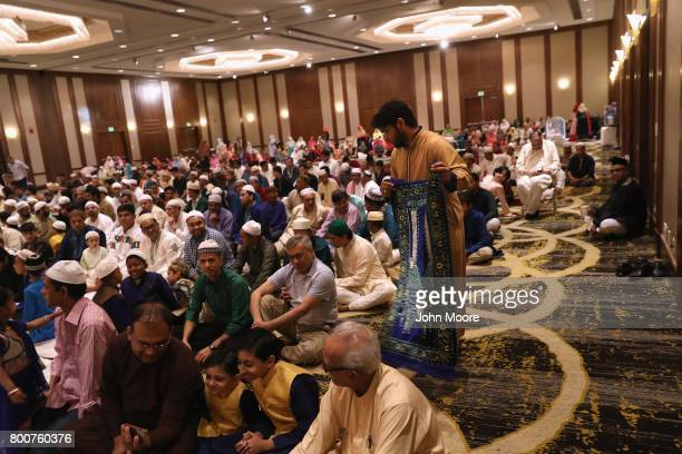 Muslims attend a prayer service celebrating EidalFitr on June 25 2017 in Stamford Connecticut The Islamic holiday celebrates the end of the Ramadan...