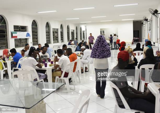 Muslims attend an iftar dinner during the holy month of Ramadan which is the ninth month of the Islamic calendar at Masjid El Nur in Rio De Janeiro...