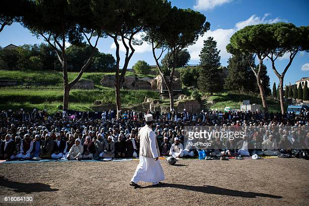 Muslims attend Friday prayers during a demonstration near Rome's ancient Colosseum in Rome Italy The Muslim community take to streets to pray and to...