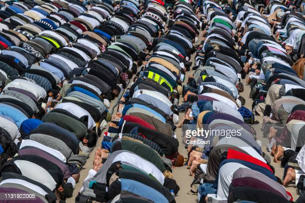 Muslims attend Friday prayers in a park near Al Noor mosque on March 22 2019 in Christchurch New Zealand 50 people were killed and dozens were...