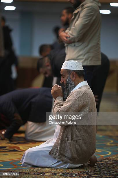 Muslims attend prayers at Manchester Central Mosque where they prayed for British aid worker Alan Henning and Imam Asim Hussain condemning his murder...