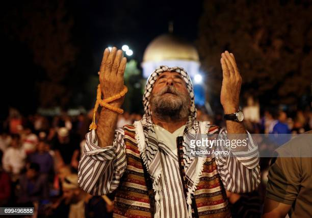 Muslims attend the mass prayer at the Al-Aqsa Mosque Compound, to mark Laylat al-Qadr, holiest of the Muslims' five holy nights during the Muslims'...