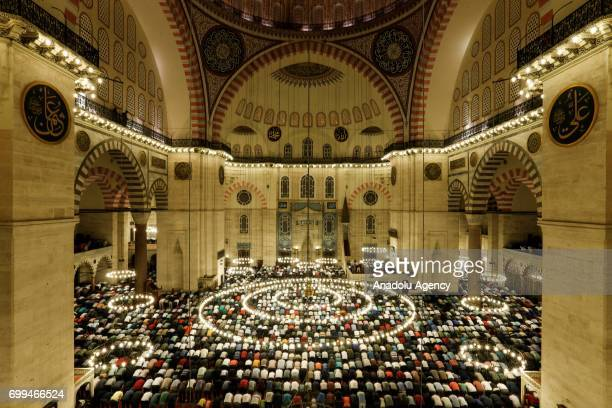 Muslims attend the mass prayer at the historical Sultan Ahmed Mosque known as Blue Mosque to mark Laylat alQadr holiest of the Muslims' five holy...