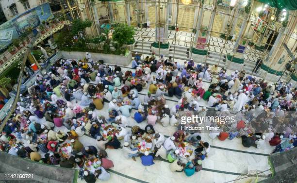 Muslims break the day long fast on the first day of holy month of Ramzan at Minara Masjid on May 7 2019 in Mumbai India
