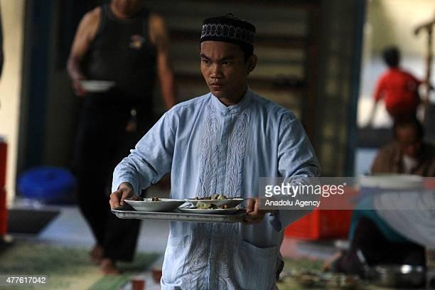 Muslims break their fast at a fastbreaking dinner during Ramadan in Surakarta Central Java Indonesia on June 18 2015