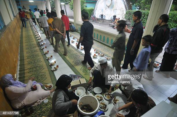 Muslims break their fast at the Grand Mosque in Solo Central Java Indonesia on June 29 2014 Every day during the holy month Ramadan board of the...