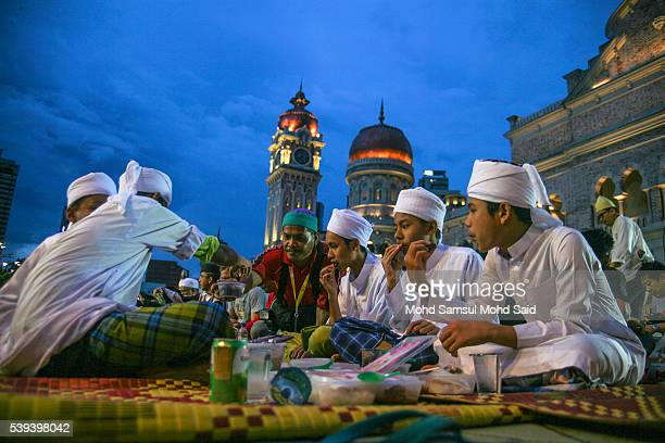 Muslims break their fast during the holy month of Ramadan at Dataran Merdeka on June 11 2016 in Kuala Lumpur Malaysia Muslims around the world are...