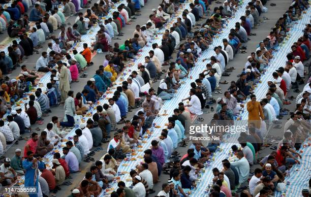Muslims break their fast with Iftar during the holy month of Ramadan on May 06 2019 in Dubai United Arab Emirates Muslim men and women across the...