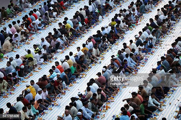 Muslims break their fast with iftar during the holy month of Ramadan on June 20 2016 in Dubai United Arab Emirates Muslim men and women across the...