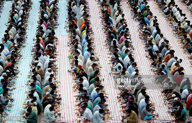 Muslims break their fast with iftar during the holy month of Ramadan on June 15 2016 in Dubai United Arab Emirates Muslim men and women across the...