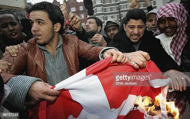 Muslims burn a Danish Flag outside the Danish Embassy February 3 2006 in London England Hundreds of British Muslims are protesting outside the Danish...