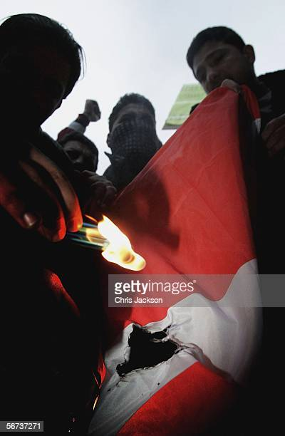 Muslims burn a Danish Flag outside the Danish Embassy February 3 2006 in London England Hundreds of British Muslims are protesting outside the Danish...