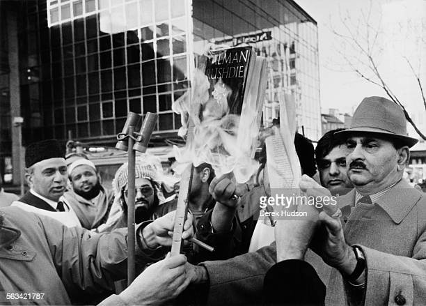Muslims burning copies of Salman Rushdie's novel 'The Satanic Verses' in Bradford UK circa 1988 The book was deemed offensive by many Muslims and...