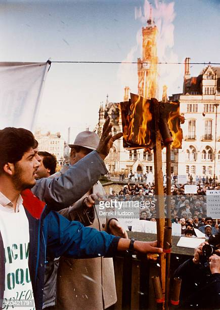 Muslims burning copies of Salman Rushdie's novel 'The Satanic Verses' in front of Bradford City Hall Bradford UK circa 1988 The book was deemed...