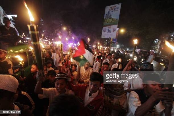 Muslims carry torches during a parade within the 1 Muharram 1440 Hijriah celebrations marking Islamic new year in Tajur Bogor West Java Indonesia on...